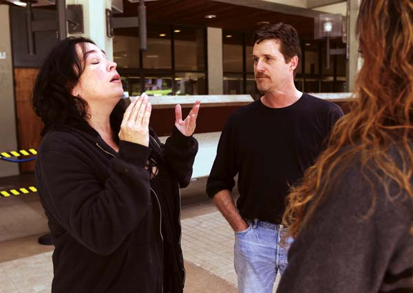 Carly Scott's mother, Kimberlyn (from left), talks to Scott's father, Robert, and Victim Witness Division Director Ana Makoni on Wednesday afternoon outside the Wailuku Courthouse. The Maui News / CHRIS SUGIDONO photo