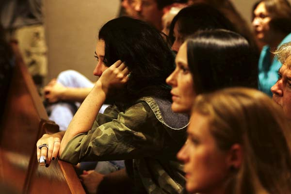 Phaedra Wais, younger sister of Carly Scott, watches Wednesday's court proceedings with friends and family in 2nd Circuit Court. The Maui News / CHRIS SUGIDONO photo