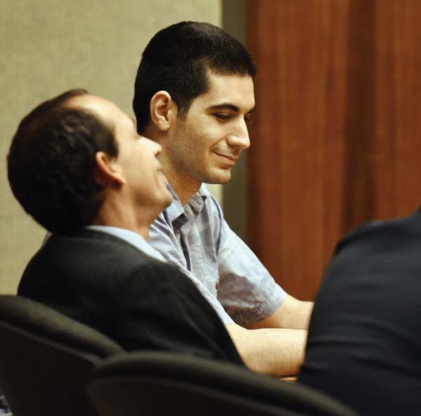 Murder defendant Stephen Capobianco shares a rare smile in court with defense attorney Matthew Nardi before Wednesday's court proceedings. The Maui News / MATTHEW THAYER photo
