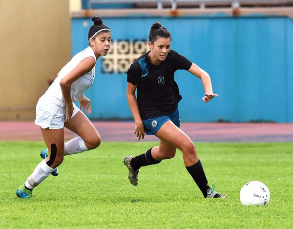 King Kekaulike High School's Darian Fernandez dribbles as Maui High's Azita Rodrigues defends on Thursday. The Maui News / MATTHEW THAYER photo