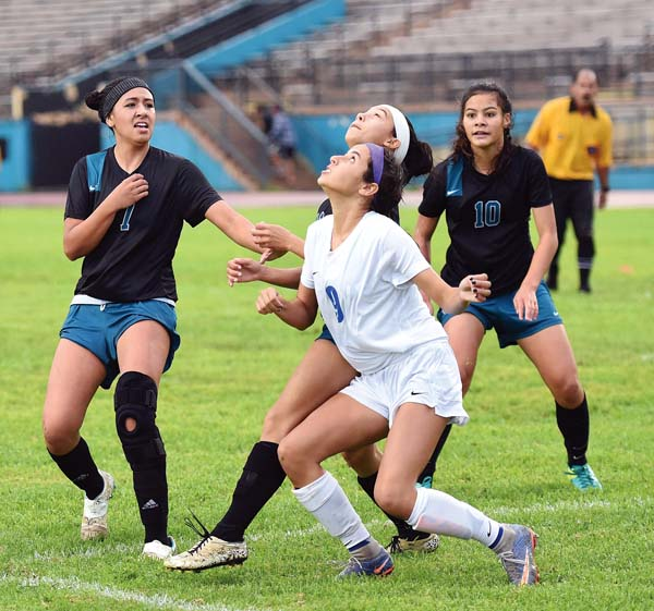 Maui High's Ashelen Grasso battles for position for a first-half header with (from left) King Keakulike's Alyssa Robinson, Erynn Duquette and Lyti Akinaka. The Maui News / MATTHEW THAYER photo