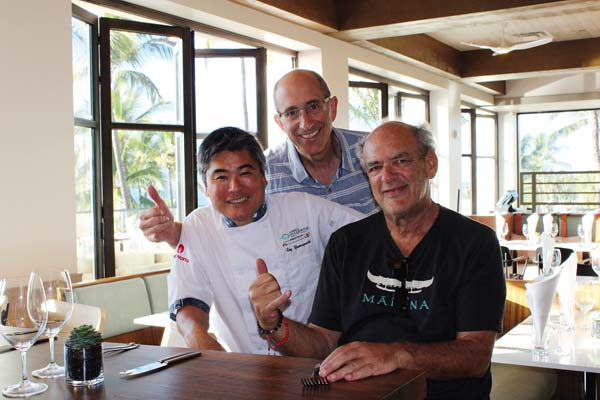 Chef restaurateur Roy Yamaguchi (from left) with Sunstone Hotel Investors COO Marc Hoffman and restaurant partner Shep Gordon at the new Humble Market Kitchin that opened Monday to the public at the newly named and renovated Wailea Beach Resort. The Maui News / CARLA TRACY photo