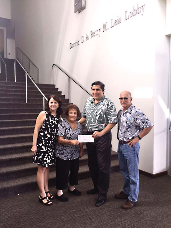 Betty Leis presents a check to Art Vento, president and CEO of the Maui Arts & Cultural Center, earlier this month. Leis' children Nancy Leis Overton and Stephen Leis appear in this photo. The Dorvin and Betty Leis Charitable Trust handed out a total of $1.5 million to 17 Maui nonprofit agencies. Leis family photo
