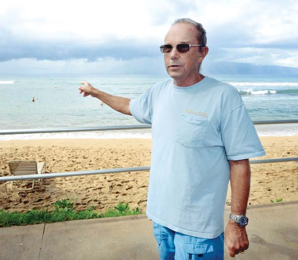 Don McLeish points to Honokowai Point, where he has saved many swimmers from the dangerous rip current. He's towed more than 100 people out of the rip current since 2009, likely saving their lives. The Maui News / MATTHEW THAYER photo