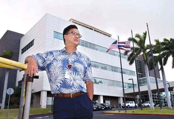 Wesley Lo, the former chief executive officer of the quasi-public entity that runs Maui Memorial Medical Center, led efforts to improve the Wailuku hospital, including the construction of the wing in the background. He also led the difficult battle to create a public-private partnership with Kaiser Permanente to operate Maui Memorial, Kula Hospital and Lanai Community Hospital. The Maui News / MATTHEW THAYER photo