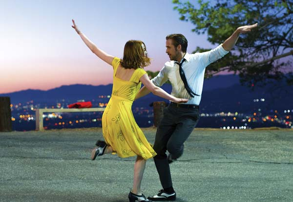 "Ryan Gosling and Emma Stone kick up their heels in ""La La Land"" Lionsgate photo via AP"