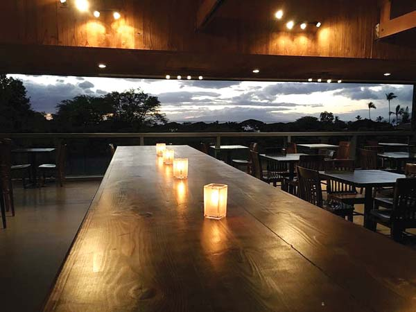 The family table is at the center of the new Wailea Kitchen & Tap and boasts 14 seats. The new eatery in the old Joe's is fast becoming a hot spot for diners and sippers as well as tennis players as it's above the Wailea Tennis Courts. Wailea Kitchen & Tap  photo
