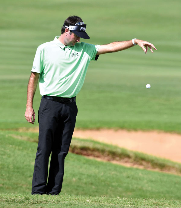 Bubba Watson takes a drop on the ninth hole. The Maui News / MATTHEW THAYER photo