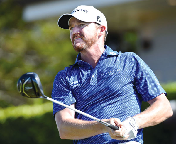 Jimmy Walker follows the flight of his drive off the first tee Thursday during the first round of the SBS Tournament of Champions at the Kapalua Plantation Course. Walker fired an 8-under-par 65 to take a two-shot lead. The Maui News / MATTHEW THAYER photo