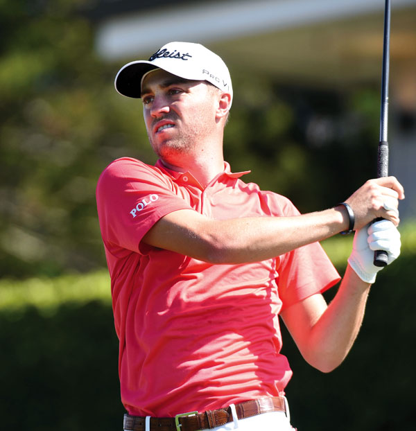 Justin Thomas tees off on the first hole. The Maui News / MATTHEW THAYER photo