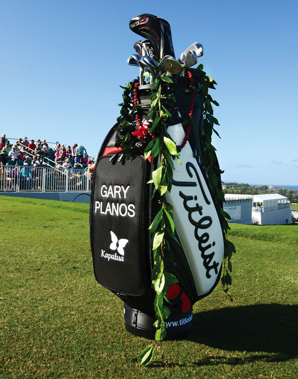 A golf bag bearing the name of the late Gary Planos sits on the first tee. The Maui News / MATTHEW THAYER photo