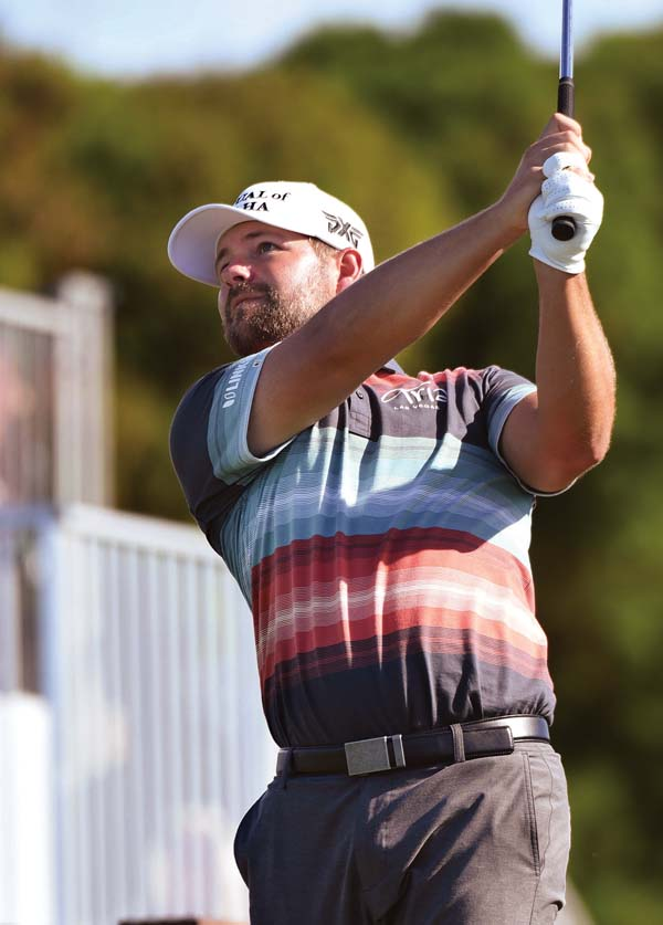 Ryan Moore hits off the 11th tee Friday during the SBS Tournament of Champions' second round.   The Maui News / MATTHEW THAYER photo