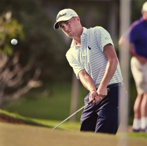 Justin Thomas watches his chip shot to the Kapalua Plantation Course's 14th green during the second round of the SBS Tournament of Champions on Friday.   The Maui News / MATTHEW THAYER photo