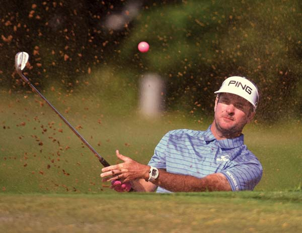 Bubba Watson blasts his pink golf ball from a trap on No. 14.   The Maui News / MATTHEW THAYER photo