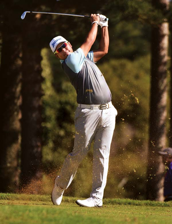 Hideki Matsuyama tees off on the second hole at the Kapalua Plantation Course on Saturday during the third round of the SBS Tournament of Champions.   The Maui News / MATTHEW THAYER photo