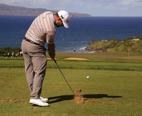 Ryan Moore tees off on No. 11.  The Maui News / MATTHEW THAYER photo