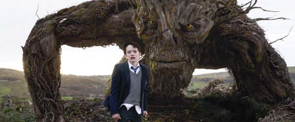 """Lewis MacDougall appears with The Monster, voiced by Liam Neeson, in """"A Monster Calls."""" Focus Features photo via AP"""