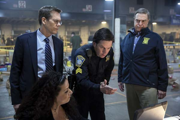 """Kevin Bacon (standing), MarkWahlberg and John Goodman star in """"Patriots Day."""" CBS Films and Lionsgate photo via AP"""