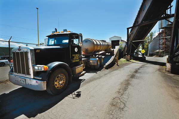 A Kahului Trucking U0026 Storage Truck Hauling Molasses Exits The Scale House  After Being Weighed. The Maui News / MATTHEW THAYER Photo