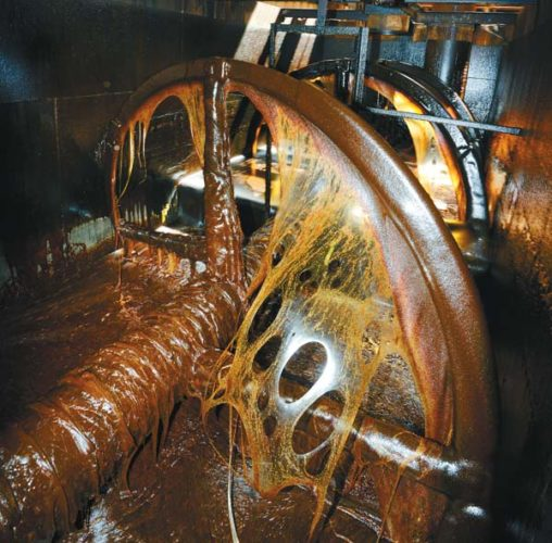 Sticky massecuite slowly cools on its way to a centrifuge to separate molasses from waste at the Puunene Mill  The Maui News / MATTHEW THAYER photo