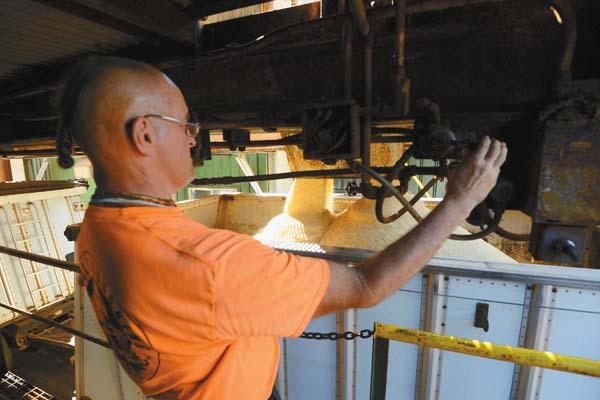 KT&S truck driver John Boyd fills his rig with sugar at Puunene Mill.  The Maui News / MATTHEW THAYER photo