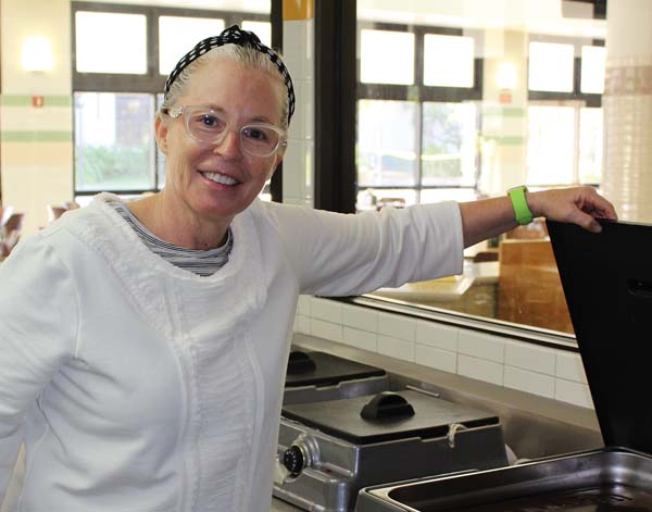 Culinary Arts Program Coordinator Teresa Shurilla oversees a vat of Guittard chocolate in her other role as pastry chef instructor.   The Maui News  / CARLA TRACY photo