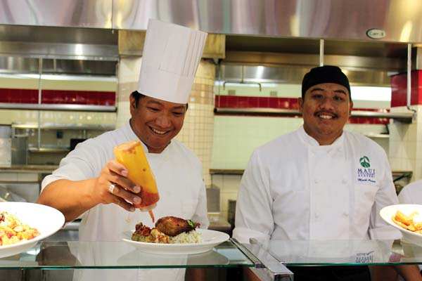 World Plate Chef-Instructor Jake Belmonte (at left) with student Mark Arcano.  The Maui News  / CARLA TRACY photo