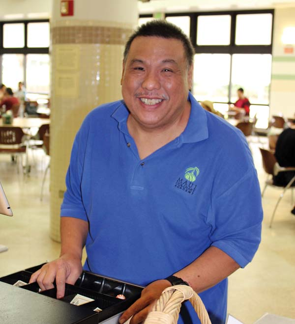 Cashier Kevin Ageno and  The Maui News  / CARLA TRACY photo