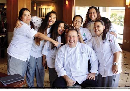 Class Act Chef Instructor Tom Lelli (seated) poses with students Joyce Rosal, Courtney Galarita, Hechelle Acob, Hanidee Cacalda, Jessica Kapoor and Tatiana Kaniaupio.  UH-MC photo