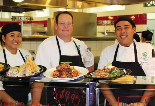 Paniolo Grill students Sheena Castillo and Edmon Vaolois flank Chef-Instructor Noel Cleary.  The Maui News  / CARLA TRACY photo