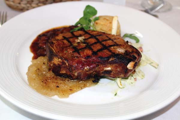 entree of grilled pork chop with Granny Smith apple sauce and shaved vegetable slaw.   The Maui News  / CARLA TRACY photo