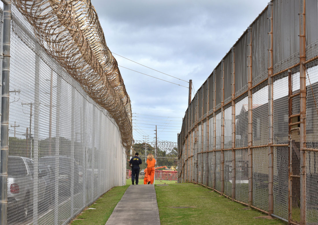 A Maui Community Correctional Center guard walks inmates to lunch Tuesday morning. The state Department of Public Safety opened up the Maui facility to reporters Tuesday. The Maui News / MATTHEW THAYER photo