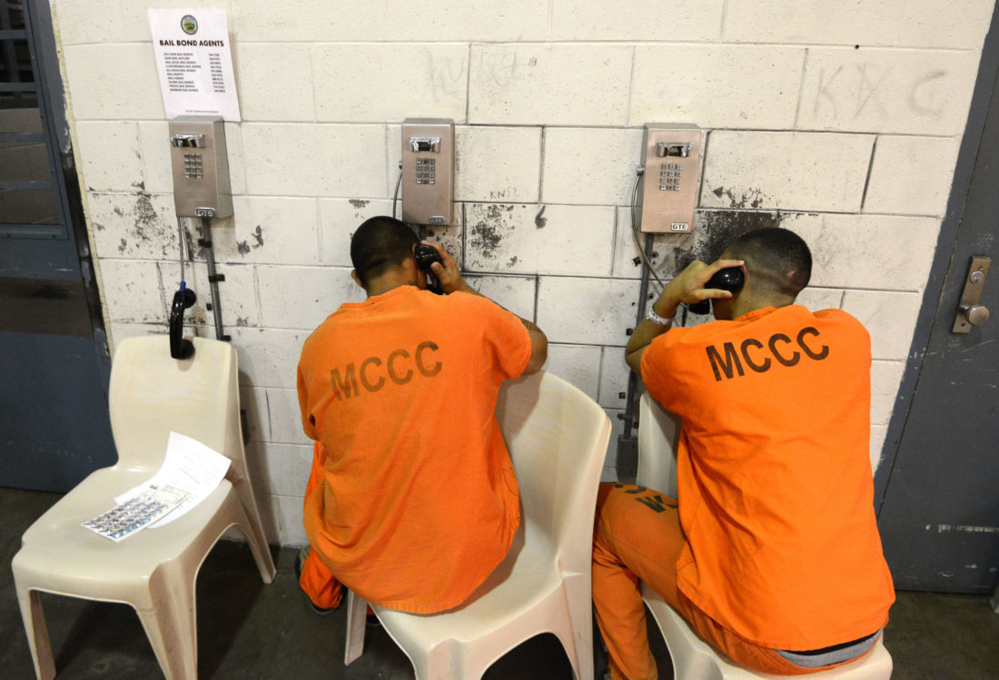 Maui Community Correctional Center inmates make telephone calls from their cellblock on Tuesday. The Maui News / MATTHEW THAYER photo