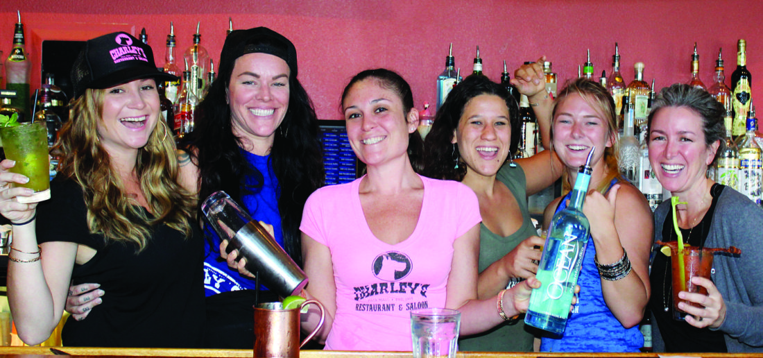 Charley's Restaurant & Saloon staff get ready to charge ahead for Super Bowl with fun drinks and pupu. They are servers Juliet Clark (from left) Lindsey Stout, bartender Malia Ness, server Sarah Johnson, hostess Oakley Jackson and general manager Renae Roberts. The Maui News / CARLA TRACY photo