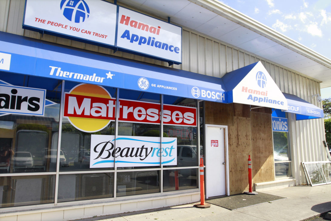 Plywood and a temporary door greet customers at Hamai Appliance after a car drove through the entrance and nearly struck a saleswoman early Saturday afternoon.  • The Maui News / CHRIS SUGIDONO photo