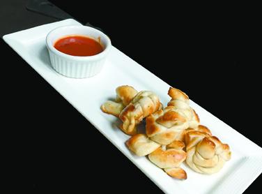 "Garlic knots at Pi Artisan Pizzeria will add some ""amore"" to your Italian feast in Lahaina. • Photo courtesy Pi Artisan Pizzeria"
