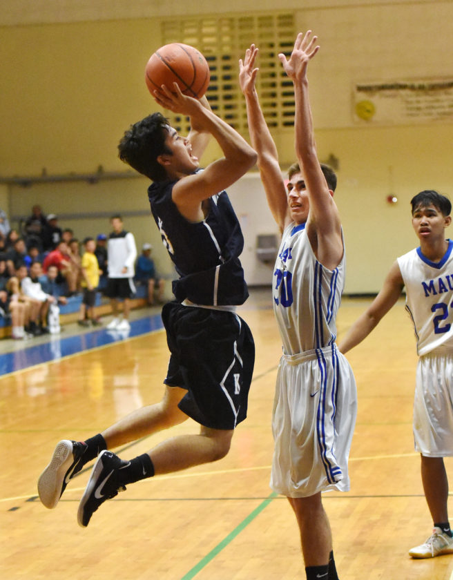 Jacob-Charles Espania of Kamehameha Schools Maui goes up for a shot as Maui High's Makana Reis defends during the second quarter of the Warriors' 61-53 win Thursday in a Maui Interscholastic League Division I tournament semifinal at the Sabers' gym. • The Maui News / MATTHEW THAYER photo