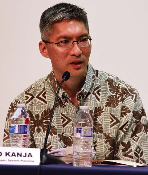 Todd Kanja, general manager of Maui Electric Co.'s system planning, answers questions Thursday night during a community discussion at the University of Hawaii Maui College.  The Maui News / CHRIS SUGIDONO photo