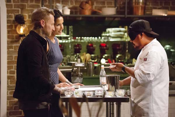 """Maui's Sheldon Simeon (right) was blindfolded in a previous episode in a test of palates. At left is Season 6 winner Michael Voltaggio with host Padma Lakshmi. Tonight, Sheldon will appear in the """"Top Chef"""" finals as the show heads south of the border to Mexico. """"Top Chef"""" photo"""