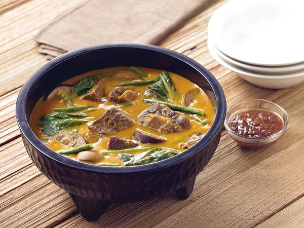 Kare kare is a savory meat stew in peanut sauce. Max's Restaurant photo