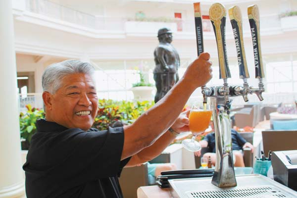 "Longtime Botero Lounge bartender Mich Domingo pours a Grand Wailea Gose (pronounced ""goh-suh"") at the resort. It evokes a taste of the islands, and is one of Grand Wailea's most requested beverages.   The Maui News / CARLA TRACY photo"
