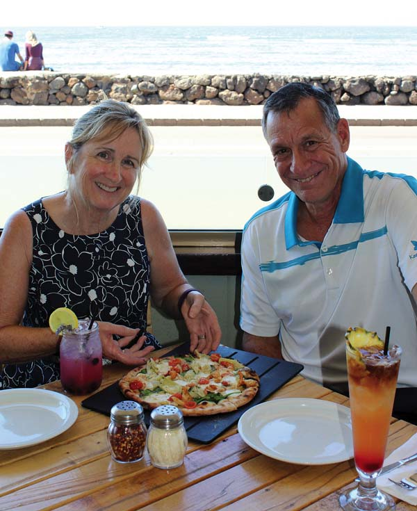 Owners Debbi and Stuart Katz enjoy the Surf's Up pie with housemade mozzarella and handcrafted cocktails on the shady outdoor lanai. Pi Artisan Pizzeria photo
