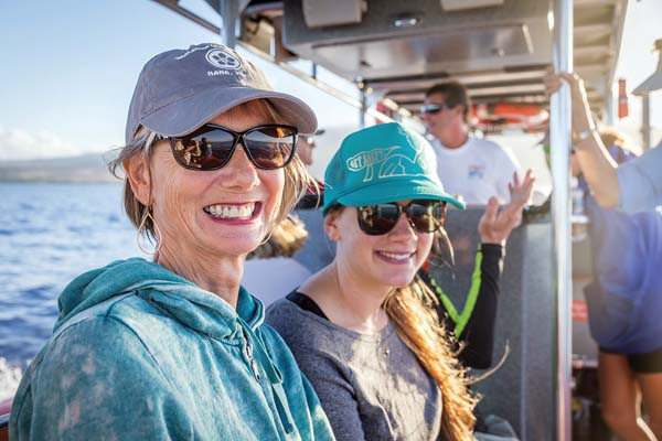 Attendees are all smiles at one of many whale watch cruises during last year's event. Photo courtesy Whale Trust Maui