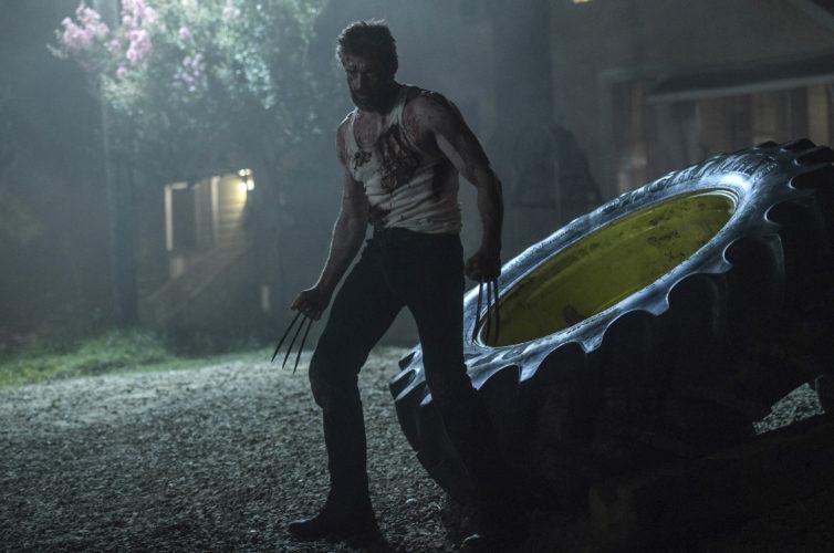 """This image released by Twentieth Century Fox shows Hugh Jackman in a scene from, """"Logan.""""  (Ben Rothstein/Twentieth Century Fox via AP)"""