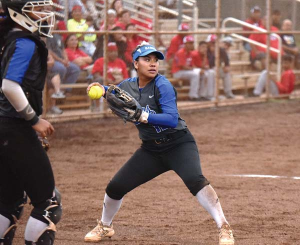 Maui High third baseman Kaimi Lay-Fuentes looks a runner back to first base after fielding a popped-up bunt as catcher Kaycee Arase looks on Thursday. The Maui News / MATTHEW THAYER photo