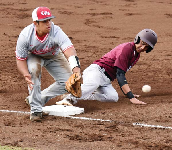 Baldwin High School's Kaipo Haole slides into third base as Lahainaluna's Anu McCabe awaits a throw in the fourth inning of the Bears' 7-0 victory over the Lunas on Thursday. The Maui News / MATTHEW THAYER photo