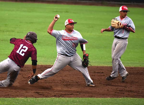 Lahainaluna shortstop Kamu Kanaha turns a sixth-inning double play after retiring Baldwin's Cade Kalehuawehe as Lunas second baseman Logan Kalawaia looks on. The Maui News / MATTHEW THAYER photo