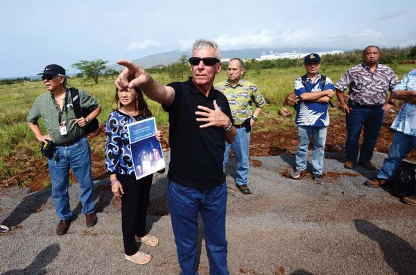 Developer representative Charlie Jencks gives state Land Use Commission members a tour of the proposed Pi'ilani Promenade on Thursday morning in north Kihei. The Maui News / MATTHEW THAYER photo