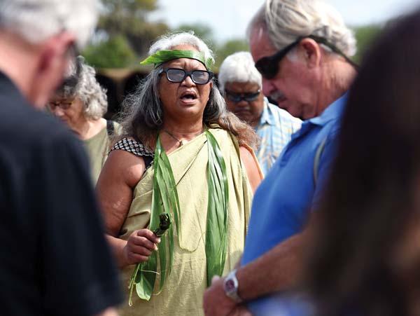 Lahaina's Vicky Kaluna-Palafox of Aha Moku o Lahaina chants a Hawaiian pule during Thursday's state Land Use Commission site visit of the Pi'ilani Promenade. The Maui News / MATTHEW THAYER photo