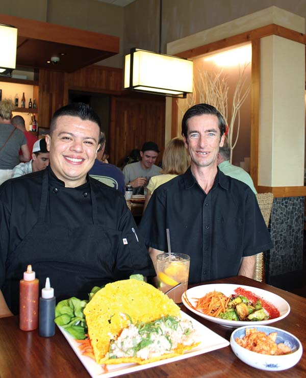 Star Noodle's Chef Cesar Perez (left) and Robert Gotfredson with famous Vietnamese crepes and more. The Maui News / CARLA TRACY photo